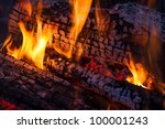 fire dances on burning  charred ... | Shutterstock . vector #100001243