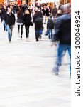 walking people in the city in motion blur - stock photo