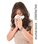 young woman with snotty, runny nose and tissue, white background - stock photo