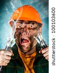 Electric shock sees a shocked electrician man - stock photo