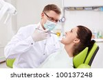 The dentist makes an injection at the clinic - stock photo
