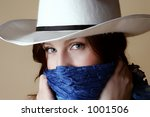 Red hair female wearing cowboy hat and bandanna - stock photo