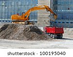 Construction site. Excavator and dumper - stock photo