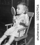 little girl looking in mirror | Shutterstock . vector #100207916