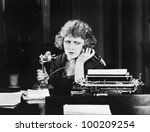 Confused Woman On Telephone