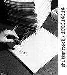 Closeup of hand stamping movie script - stock photo