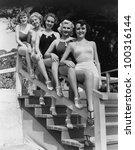 Women posing in bathing suits - stock photo