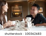 attractive couple in cafe | Shutterstock . vector #100362683