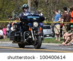 BOSTON - APRIL 16: Many Police were on duty as nearly 22500 runners participated in the Boston Marathon on a record hot day of 87 F on April 16, 2012 in Boston. - stock photo
