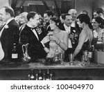 Stock photo couple having drink at crowded bar 100404970