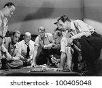 Group of men gambling - stock photo