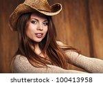 sexy woman with cowboy hat | Shutterstock . vector #100413958