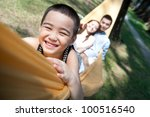 attractive asian family on a... | Shutterstock . vector #100516540