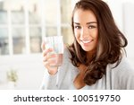 attractive young woman drinking ... | Shutterstock . vector #100519750