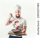 young cheerful cook man with... | Shutterstock . vector #1005207484