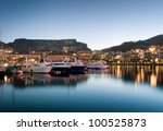 Small photo of Victoria and Alfred Waterfront as the hot summers sun sets behind Table Mountain and the night lights start to shine
