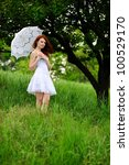 Girl portrait, walking with umbrella in park. Outdoor. - stock photo