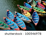 colorful boats in phewa lake ...
