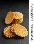 round fresh waffle  pile on a... | Shutterstock . vector #1005560140