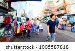 blurred people walking on khao... | Shutterstock . vector #1005587818
