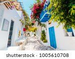 traditional greek street on... | Shutterstock . vector #1005610708