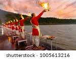 Small photo of Rishikesh, Uttarakhand - August 03 2016: Priests in red robe in the holy city of Rishikesh in Uttarakhand, India during the evening light ceremony called Ganga arthi to worship river Ganga / Ganges.