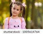 little schoolgirl with a... | Shutterstock . vector #1005614764