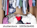 pile of clothes in wardrobe ... | Shutterstock . vector #1005636400
