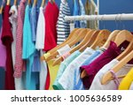 rack with different clothes ... | Shutterstock . vector #1005636589