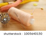 spool of sewing thread with... | Shutterstock . vector #1005640150