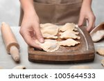 woman putting dumpling onto... | Shutterstock . vector #1005644533