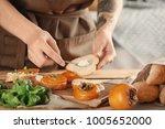 woman preparing delicious... | Shutterstock . vector #1005652000