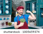 man's power in cabbage. chef's... | Shutterstock . vector #1005659374