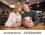 a couple is sitting in the cafe ... | Shutterstock . vector #1005666484
