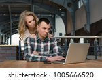 a couple is working on the... | Shutterstock . vector #1005666520