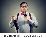 concentrated man holding bottle ... | Shutterstock . vector #1005666724