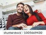 young couple having romantic... | Shutterstock . vector #1005669430