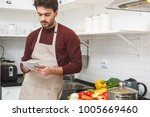 young man cooking romantic... | Shutterstock . vector #1005669460