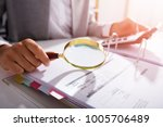 Small photo of Photo Of Businesswoman Analyzing Invoice With Magnifying Glass