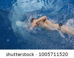 male swimmer at the swimming... | Shutterstock . vector #1005711520