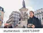 happy young woman travelling... | Shutterstock . vector #1005713449