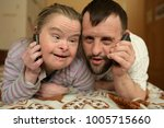 down syndrome love couple. | Shutterstock . vector #1005715660