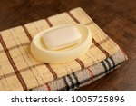 soap and a checkered bath towel.... | Shutterstock . vector #1005725896
