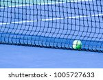 tennis balls are rolled into... | Shutterstock . vector #1005727633