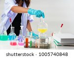the lady in white uniform with...   Shutterstock . vector #1005740848