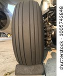 Small photo of Main wheel of aircraft is on chock when the aircraft doesn't applying the brakes.