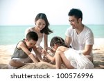 Happy Asian Family Playing On...