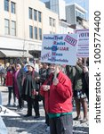 Small photo of Montgomery, Alabama, USA - January 20, 2018: Demonstrators gather near the fountain on Dexter Avenue for the 2018 Woman's March.