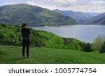 young woman admiring beautiful... | Shutterstock . vector #1005774754