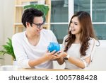 young happy asian couple smile  ... | Shutterstock . vector #1005788428